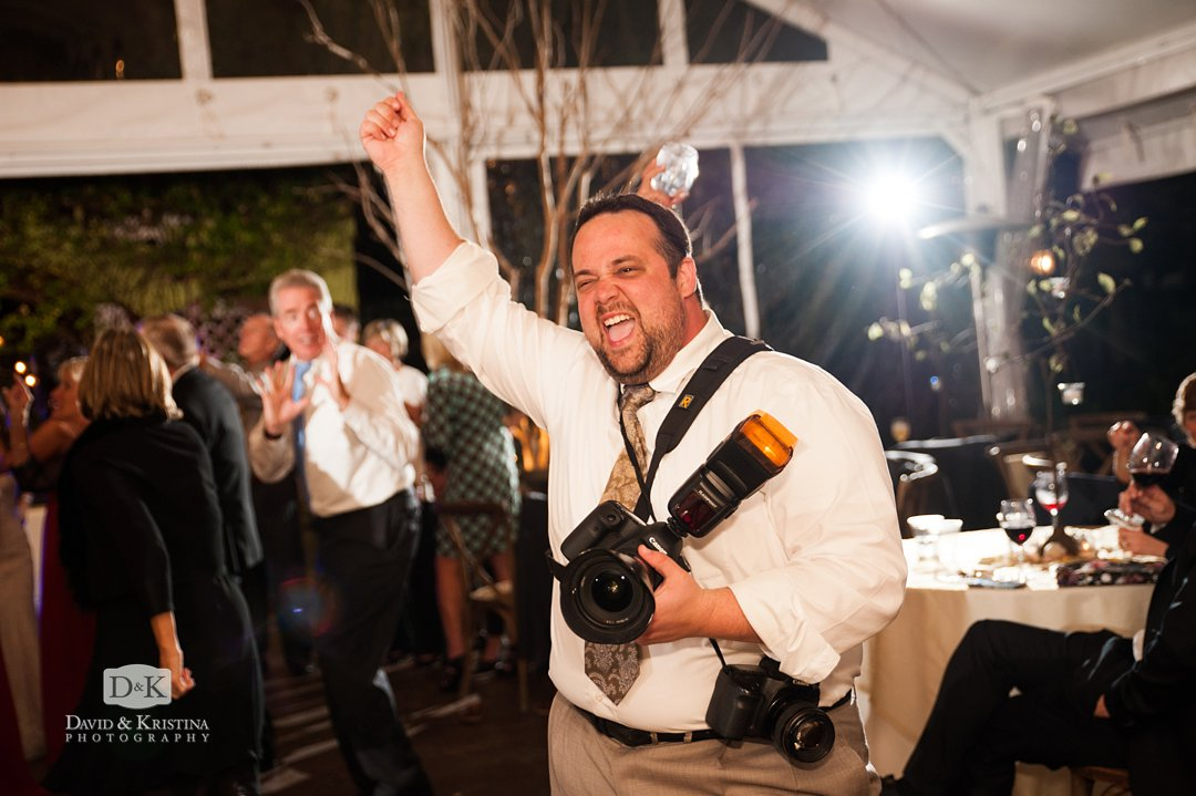 photographer dancing at wedding reception