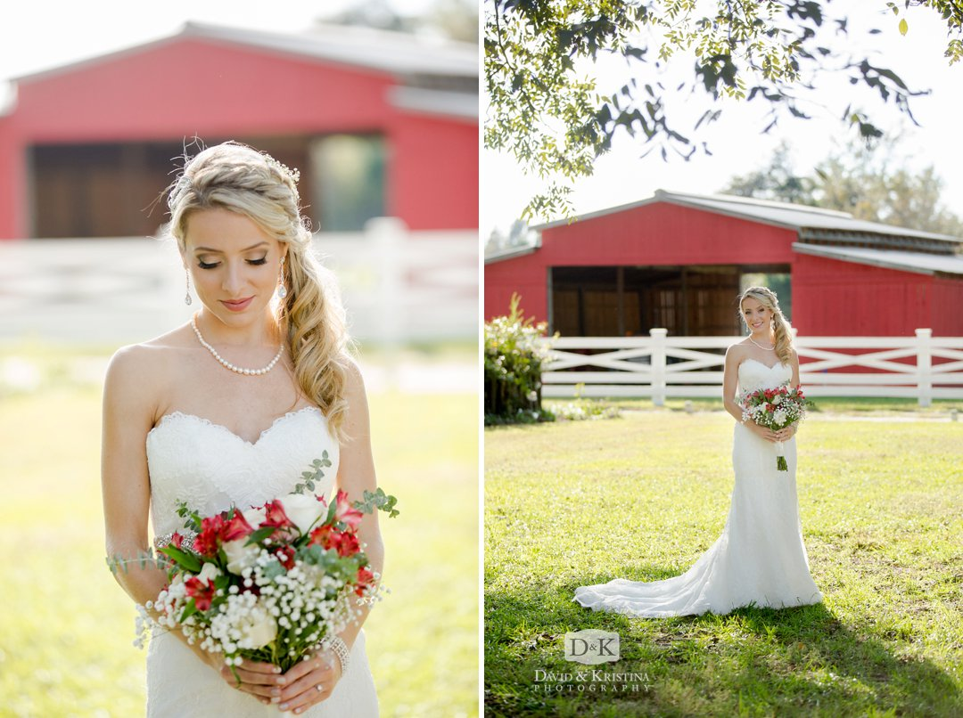 bride in wedding dress in front of Red Barn