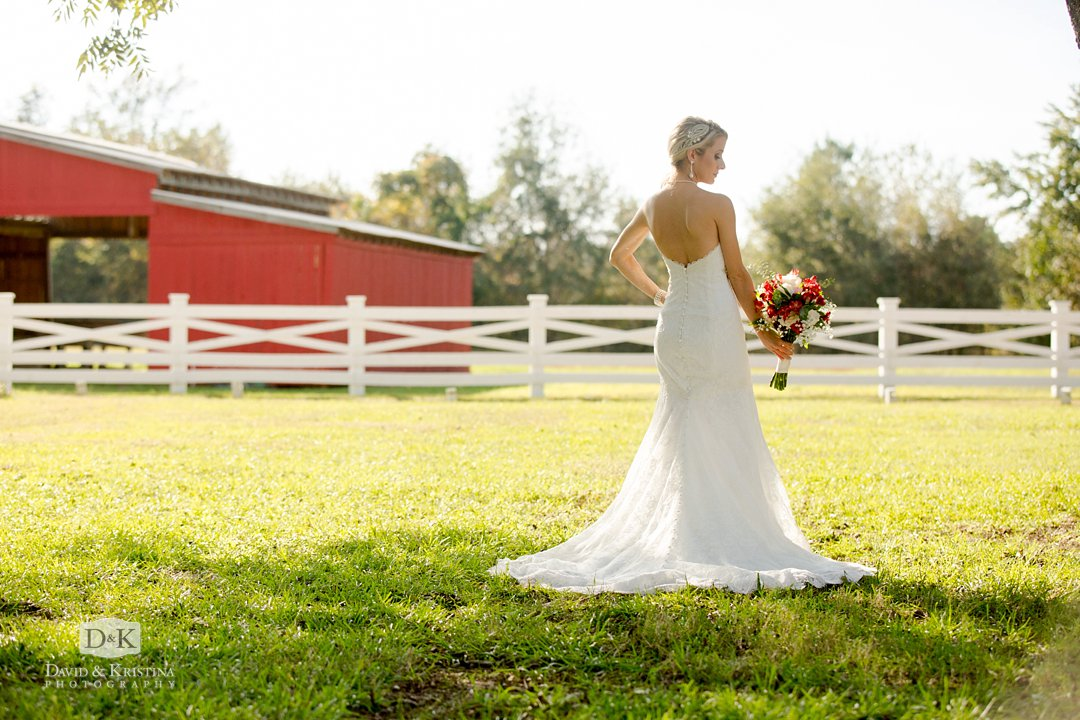 bride and red barn at Wildberry Farm