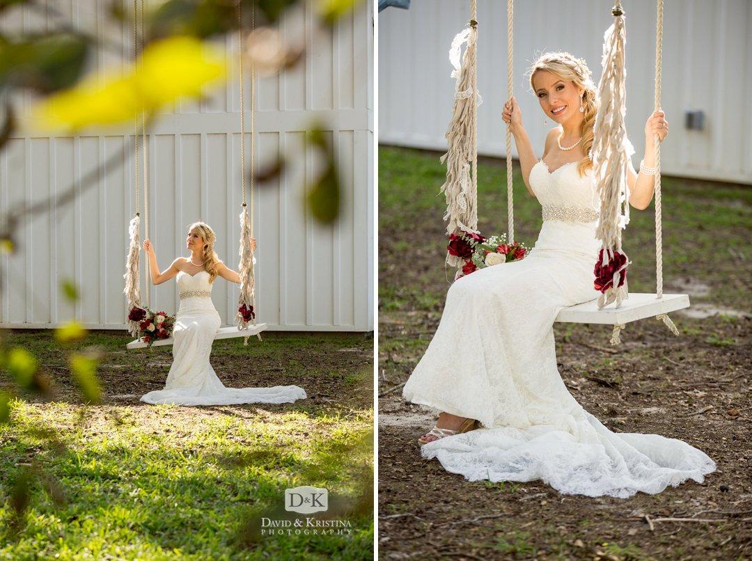 bride swinging under big oak tree at Wildberry Farm