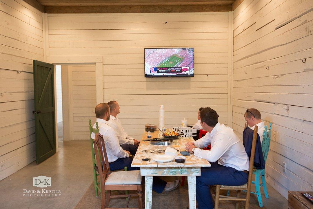 groomsmen watching football
