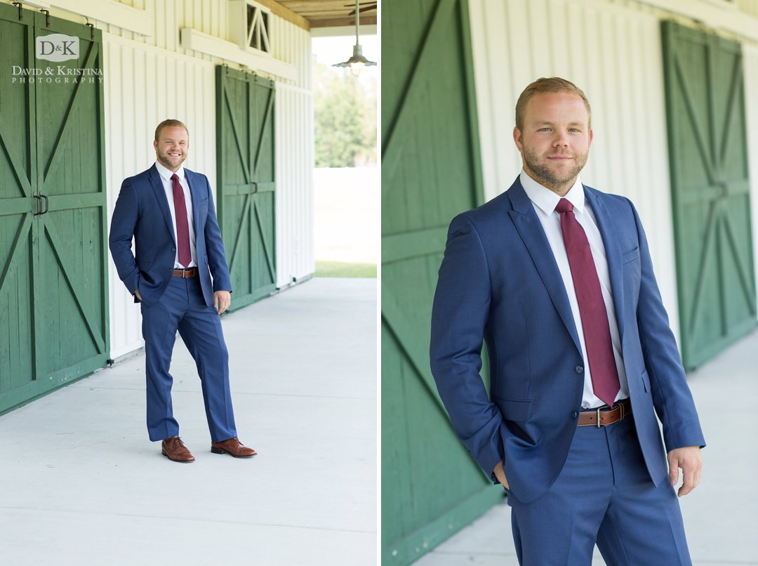 groom in front of green barn doors at Wildberry Farm
