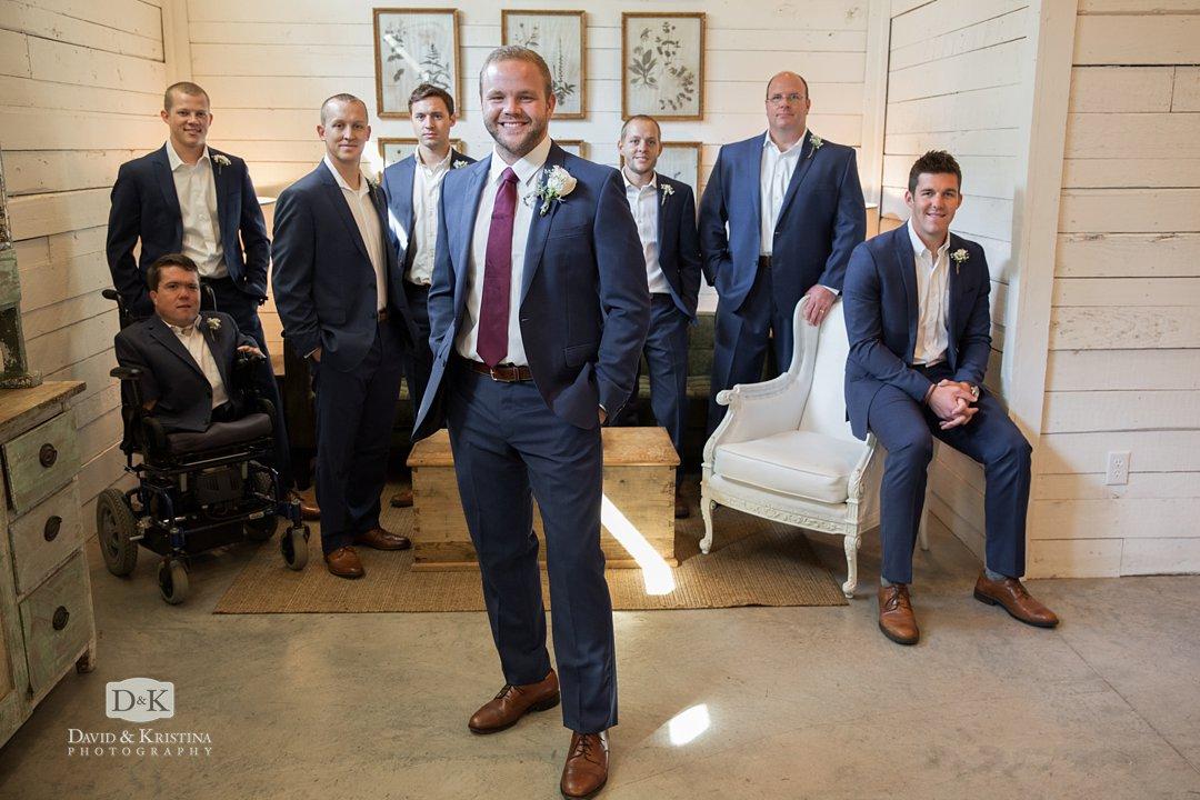 Groom and groomsmen in barn