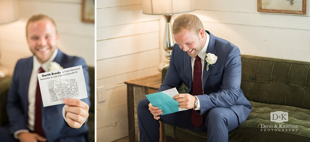 Groom opening up card from bride