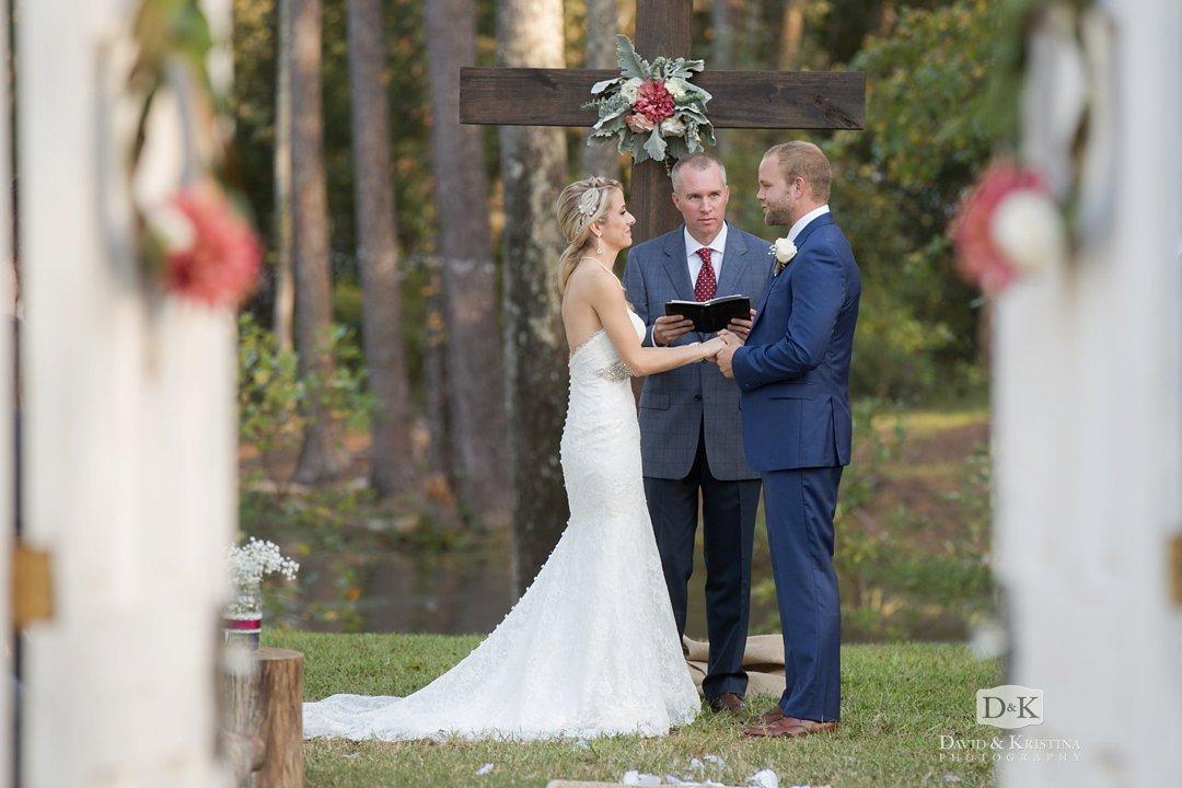 looking through doors at outdoor wedding