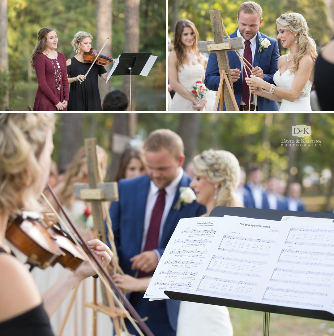 violin playing during rope braiding on wooden cross