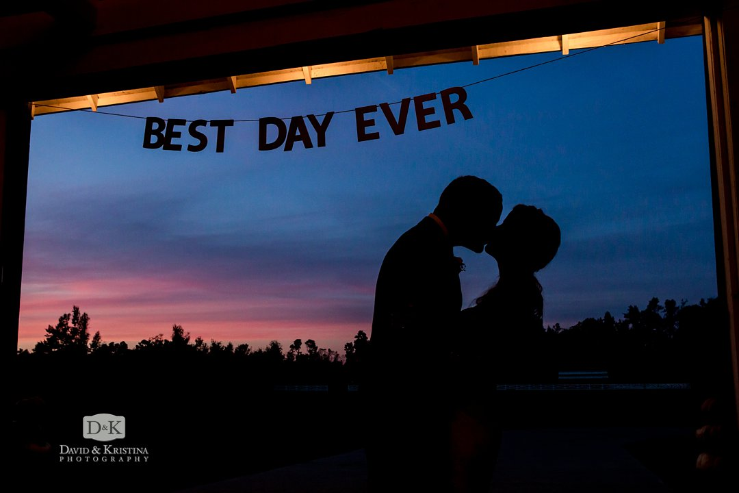 silhouette of bride and groom best day ever sign