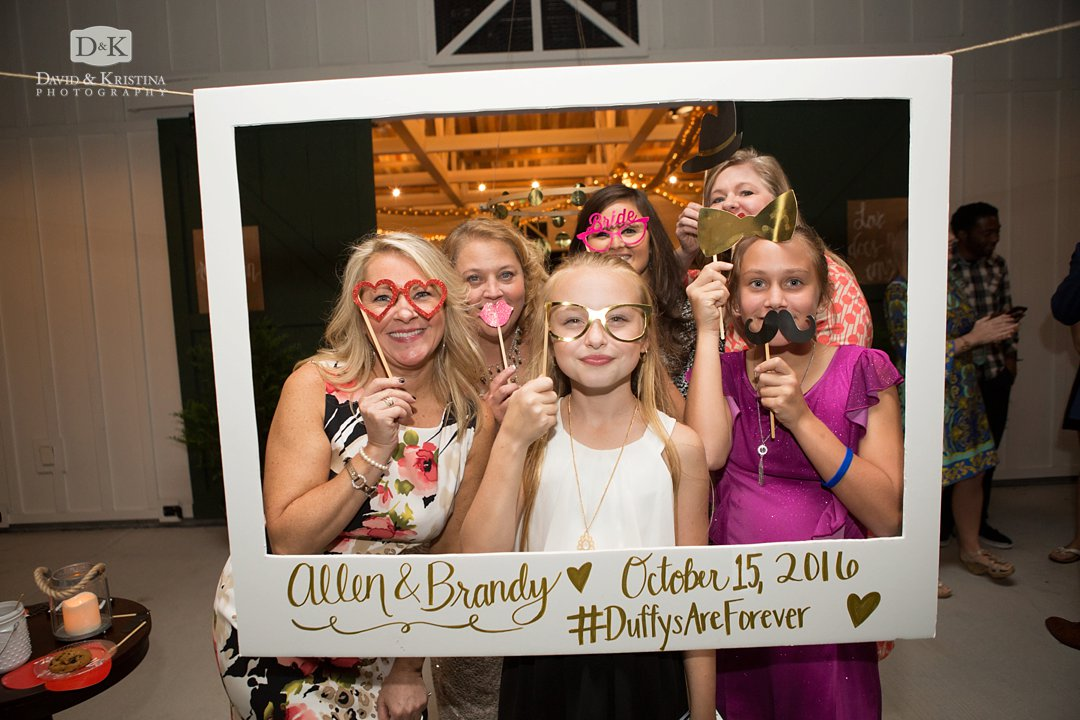 photo booth with props in hanging frame