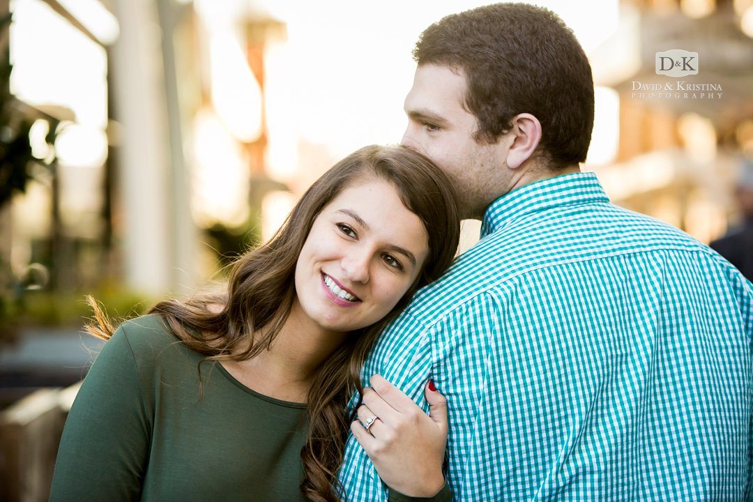 engagement photo girl leaning on guy's shoulder