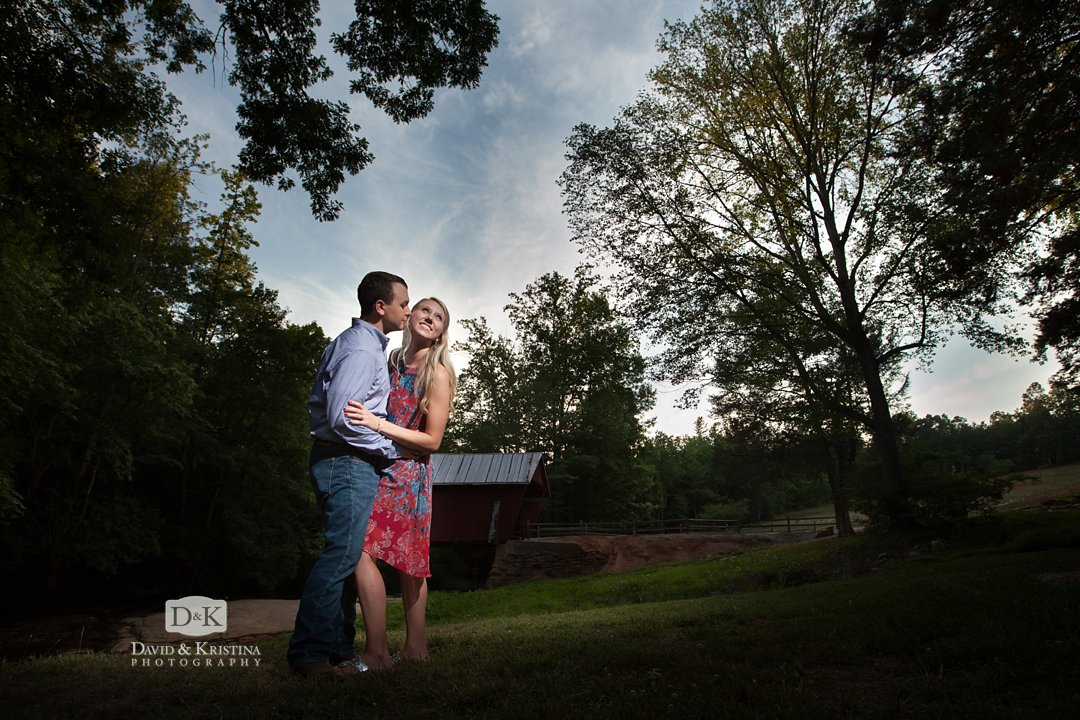 dramatic engagement photo at Campbell's Covered Bridge