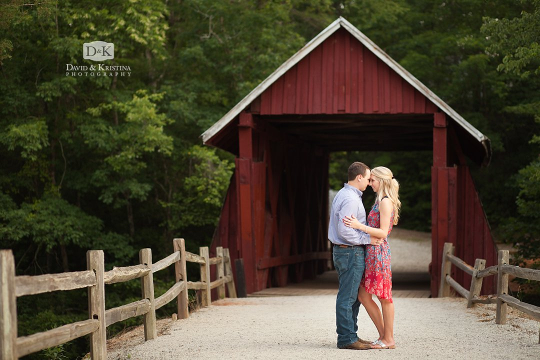 couple standing in front of Campbell's Covered Bridge in Summer