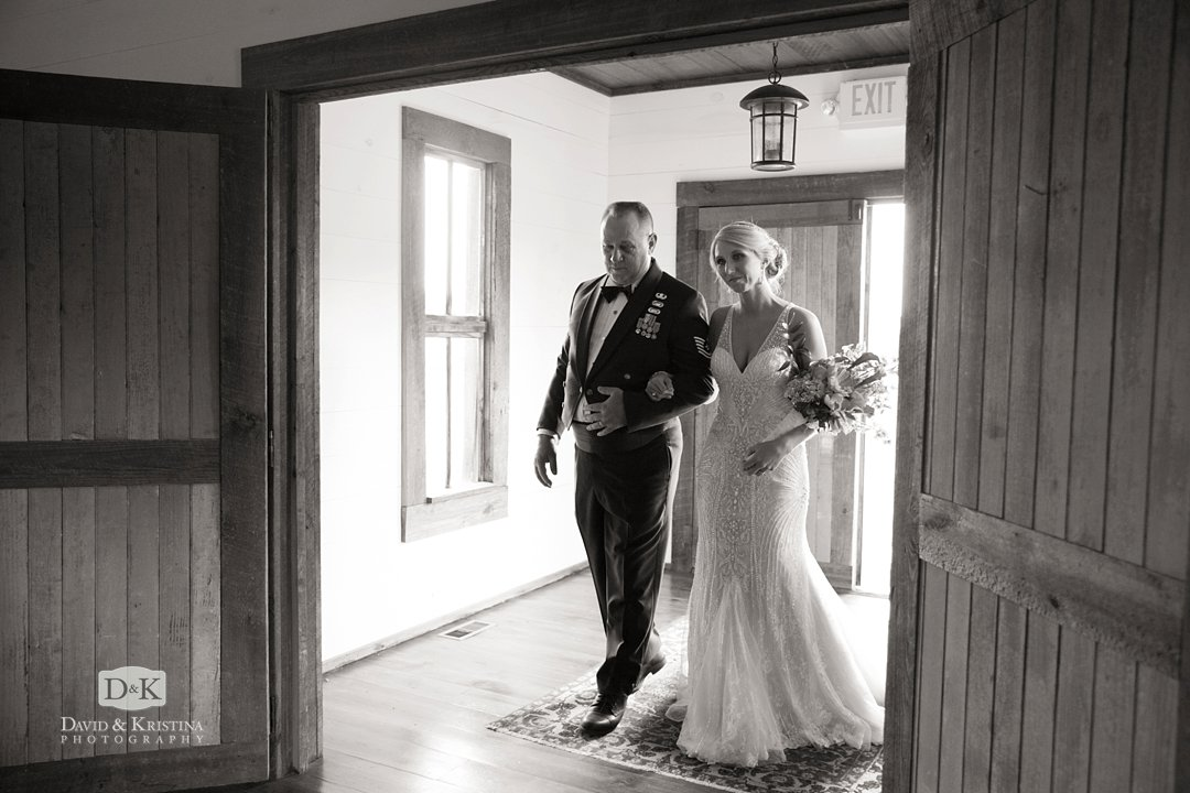 Amber and her dad walking through double doors