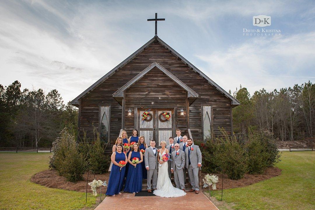 wedding party in front of chapel at Hidden Acres