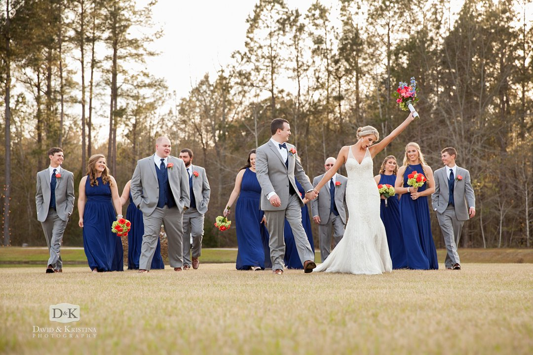 excited bride and groom with their wedding party