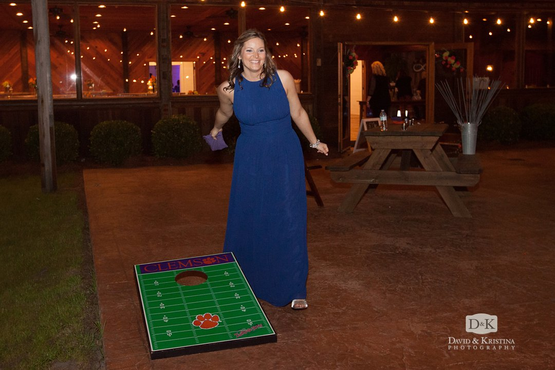 corn hole game at wedding reception