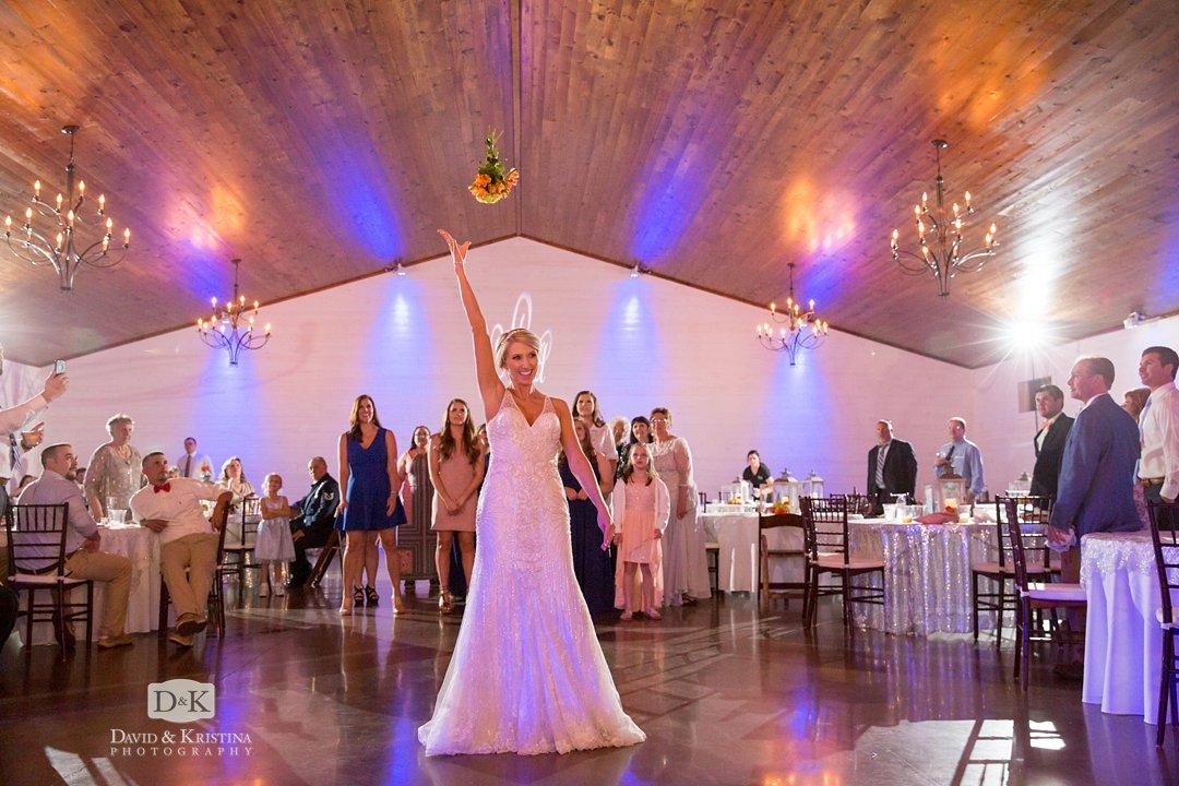 bouquet toss at Hidden Acres reception