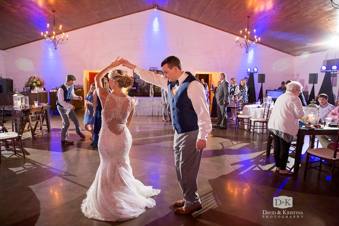 groom spins bride dancing at reception
