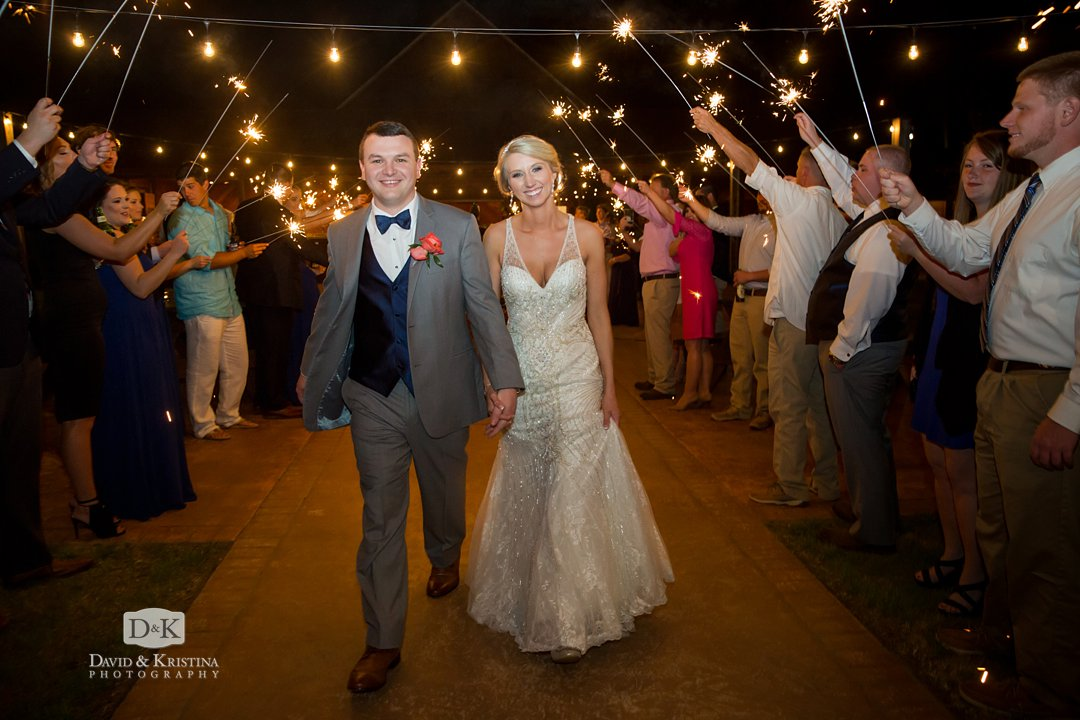 Mr and Mrs Cody Gasque leaving their wedding