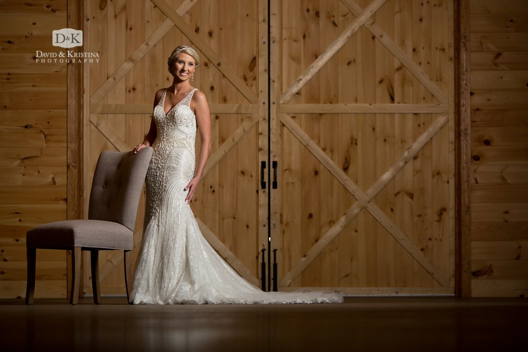 bridal portrait in front of wooden barn doors at Windy Hill Wedding and Event Barn