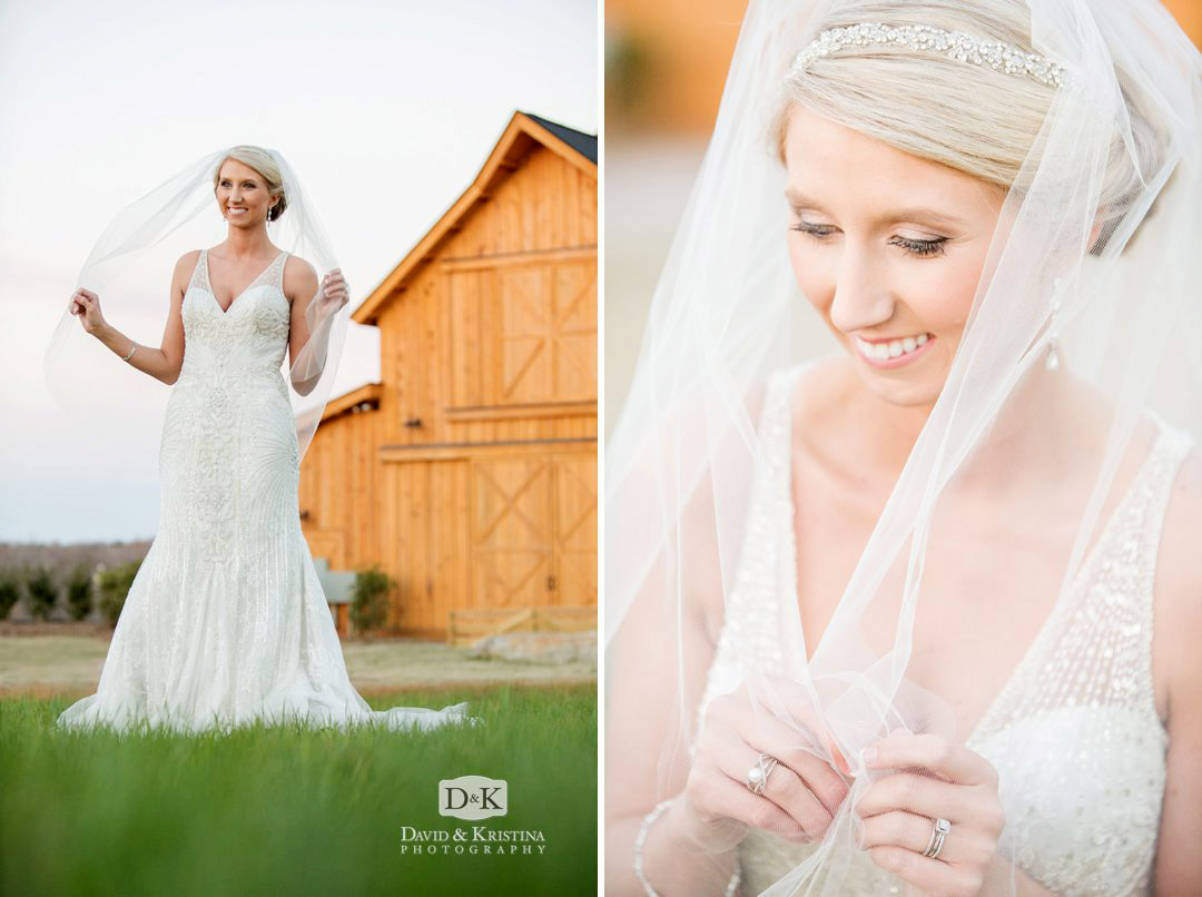 bride in front of brown wooden barn at Windy Hill farm