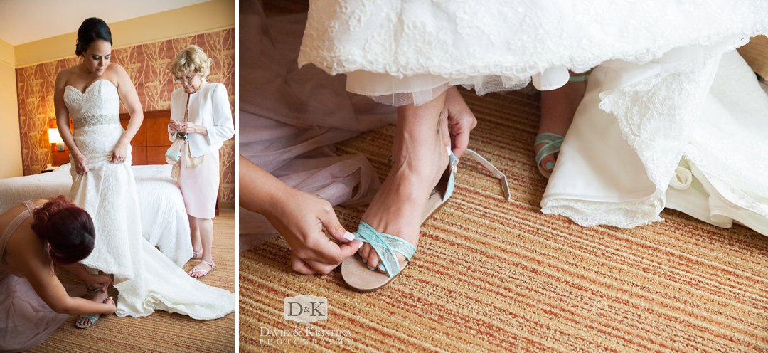 maid of honor helping bride put on shoes