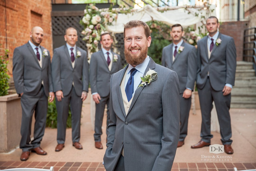 Groomsmen in courtyard at Larkin's on the River