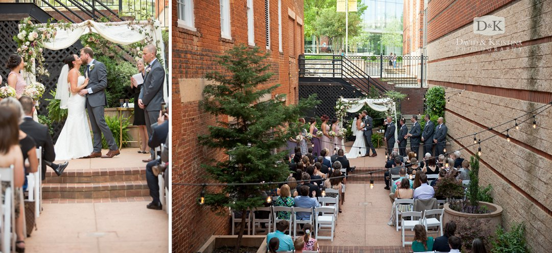 first kiss at Larkin's wedding in courtyard