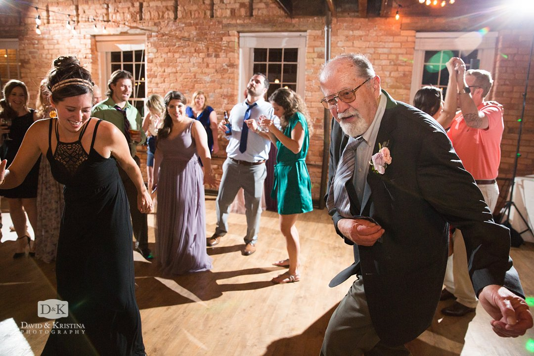 groom's father dancing at wedding reception