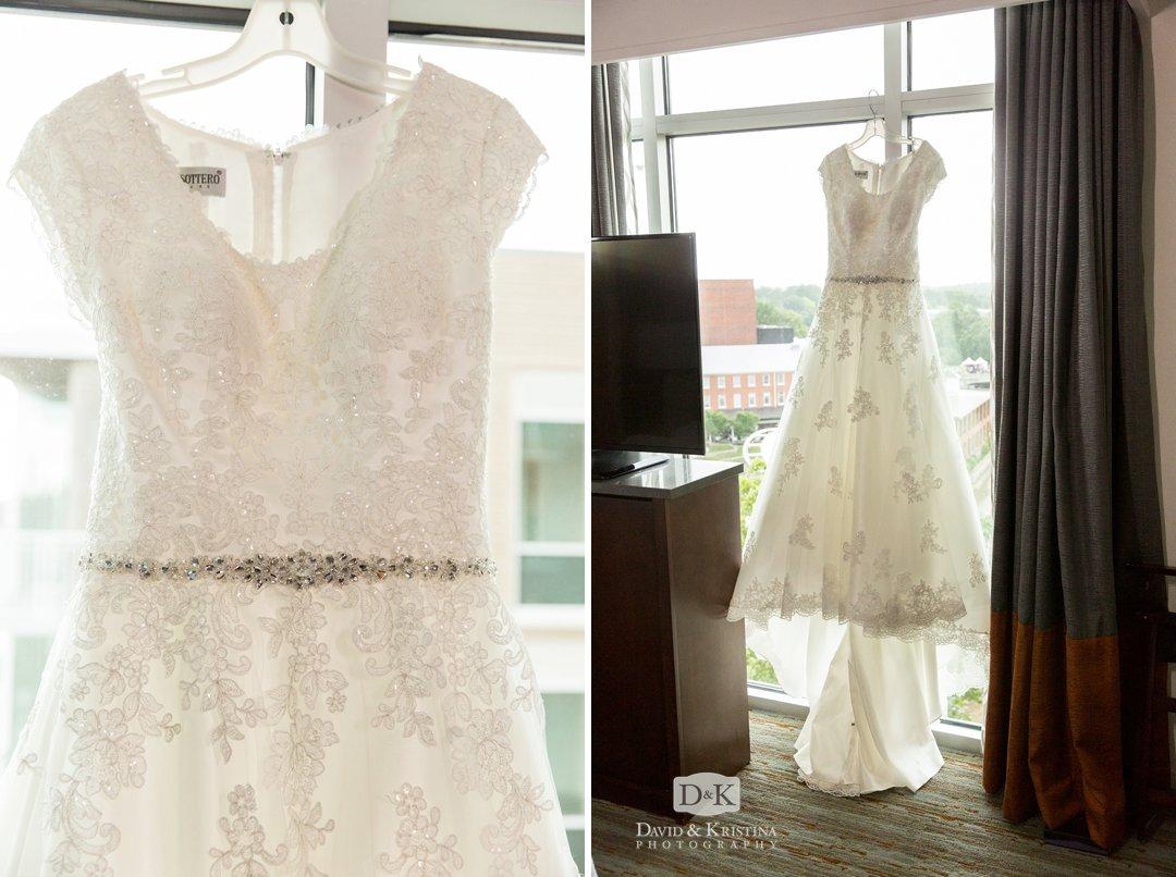 Carrie's wedding dress hanging in window