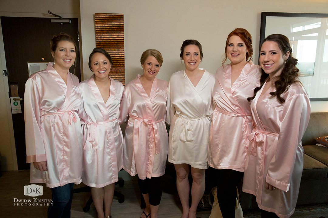 Carrie with bridesmaids in pink silk robes