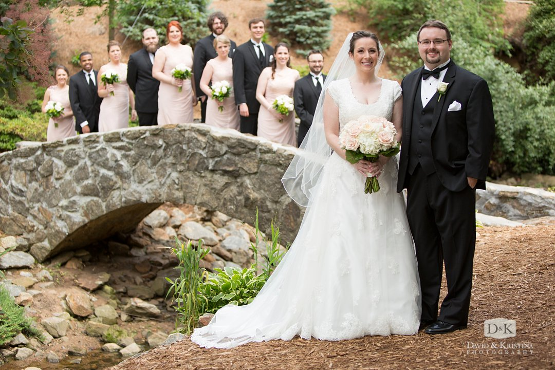 wedding photos at stone bridge in Greenville Rock Quarry Garden
