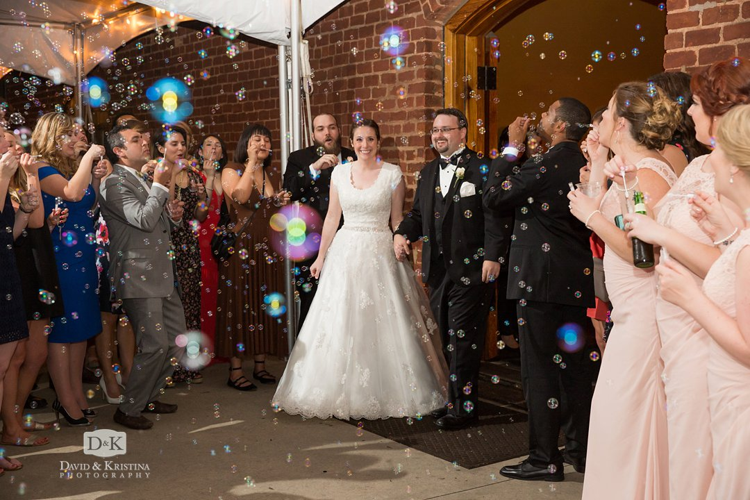 Bubbles for bride and groom exit at The Old Cigar Warehouse
