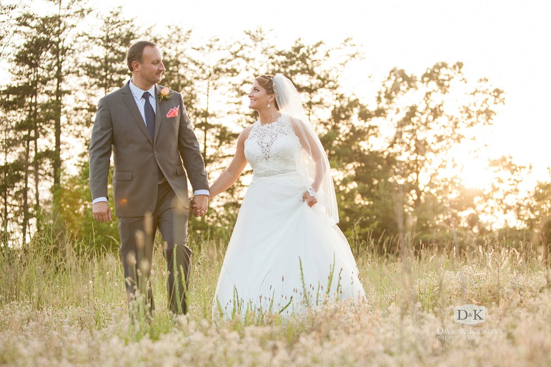 wedding photo in field at sunset in Greenville SC