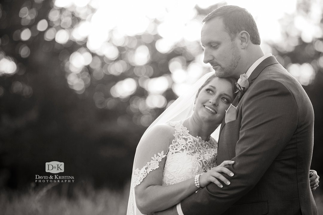 black and white wedding photo at sunset in Greenville SC