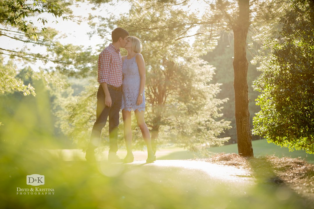 kissing photo through the trees on the cart path