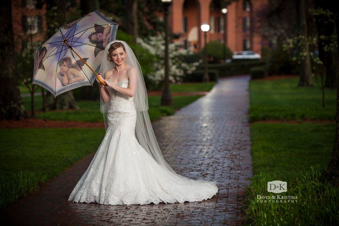 bridal portrait in the rain with umbrella