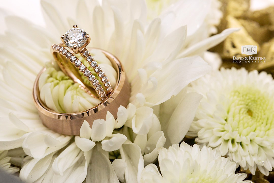 wedding bands and diamond ring in flowers