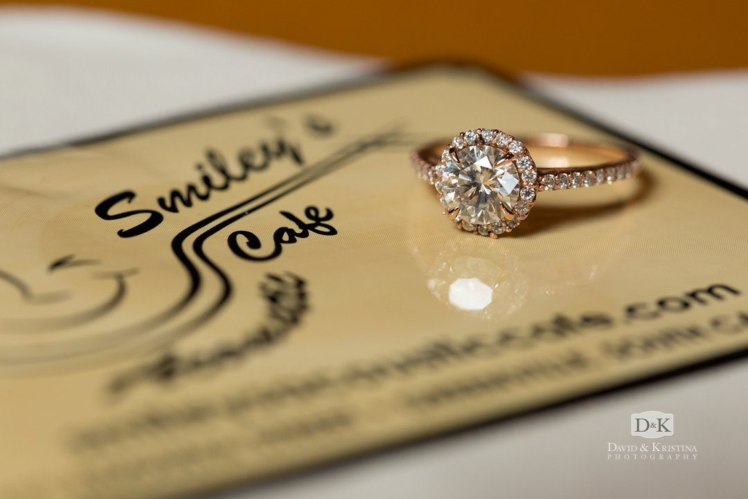 Engagement ring on Smiley's Acoustic Café sticker