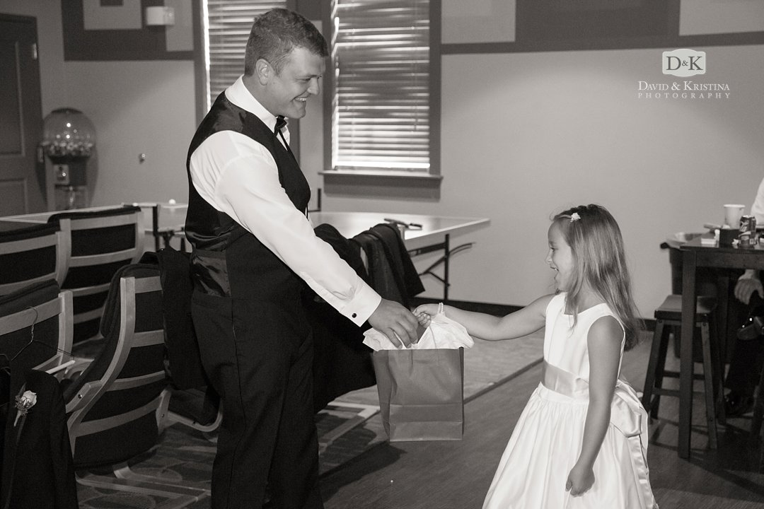 flower girl delivering gift to groom from bride