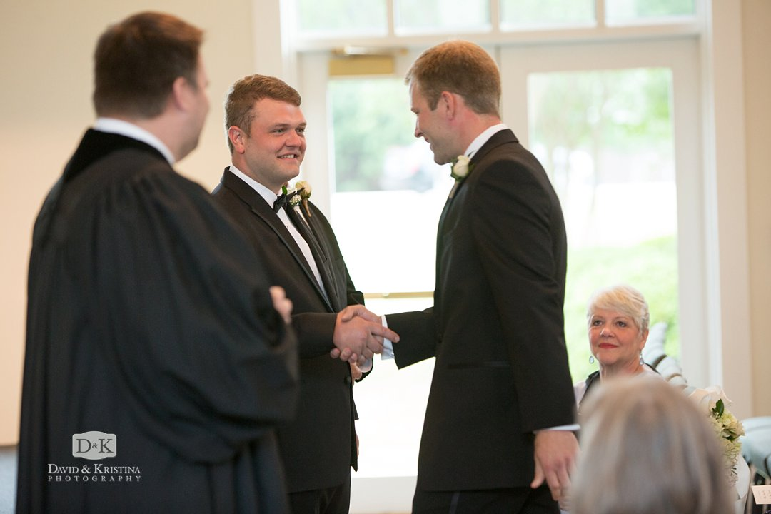 best man shaking groom's hand