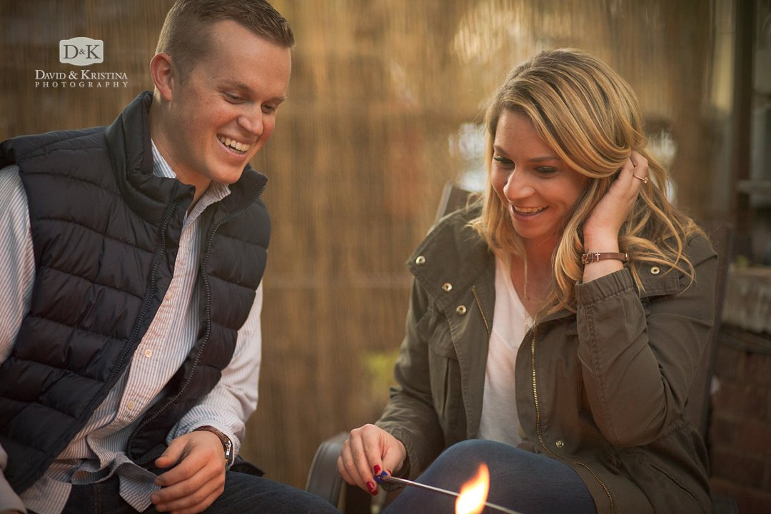 Tyler and Corie roasting marshmallows during engagement session