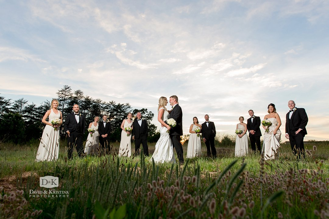 Wedding photo in grassy field near Twigs Tempietto