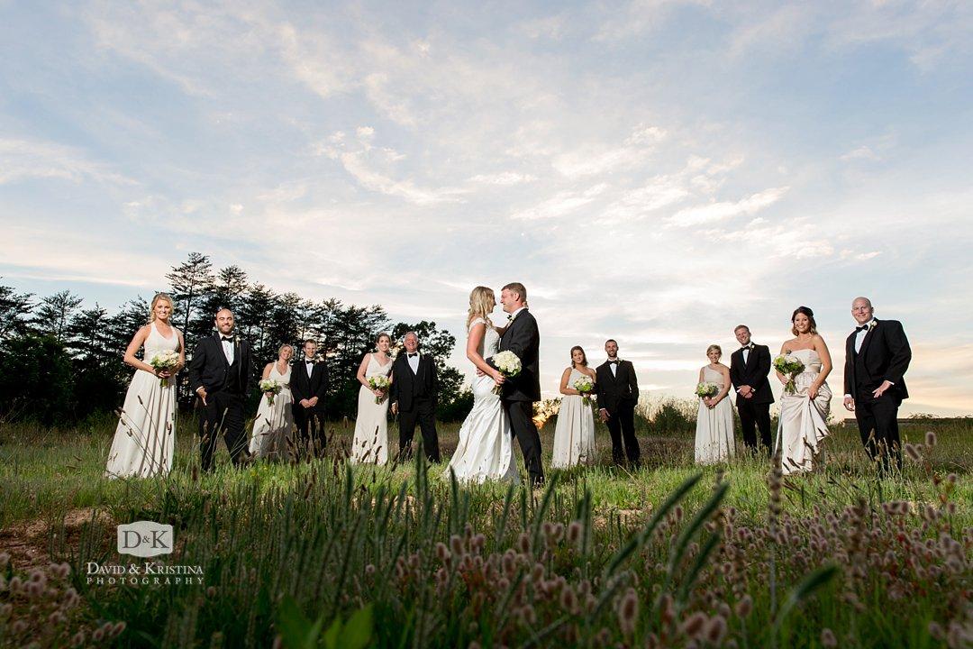 Wedding photo in grassy field near Twigs Tempietto