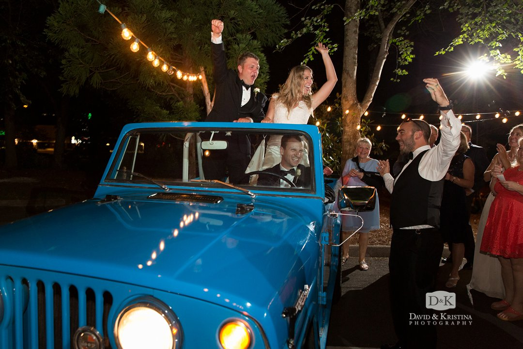 Bride and Groom leaving in back of Jeep from Twigs Tempietto
