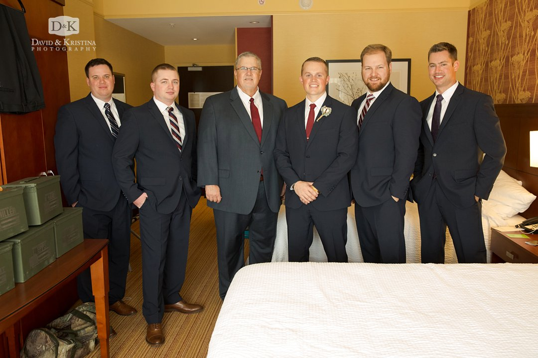 groomsmen in hotel room