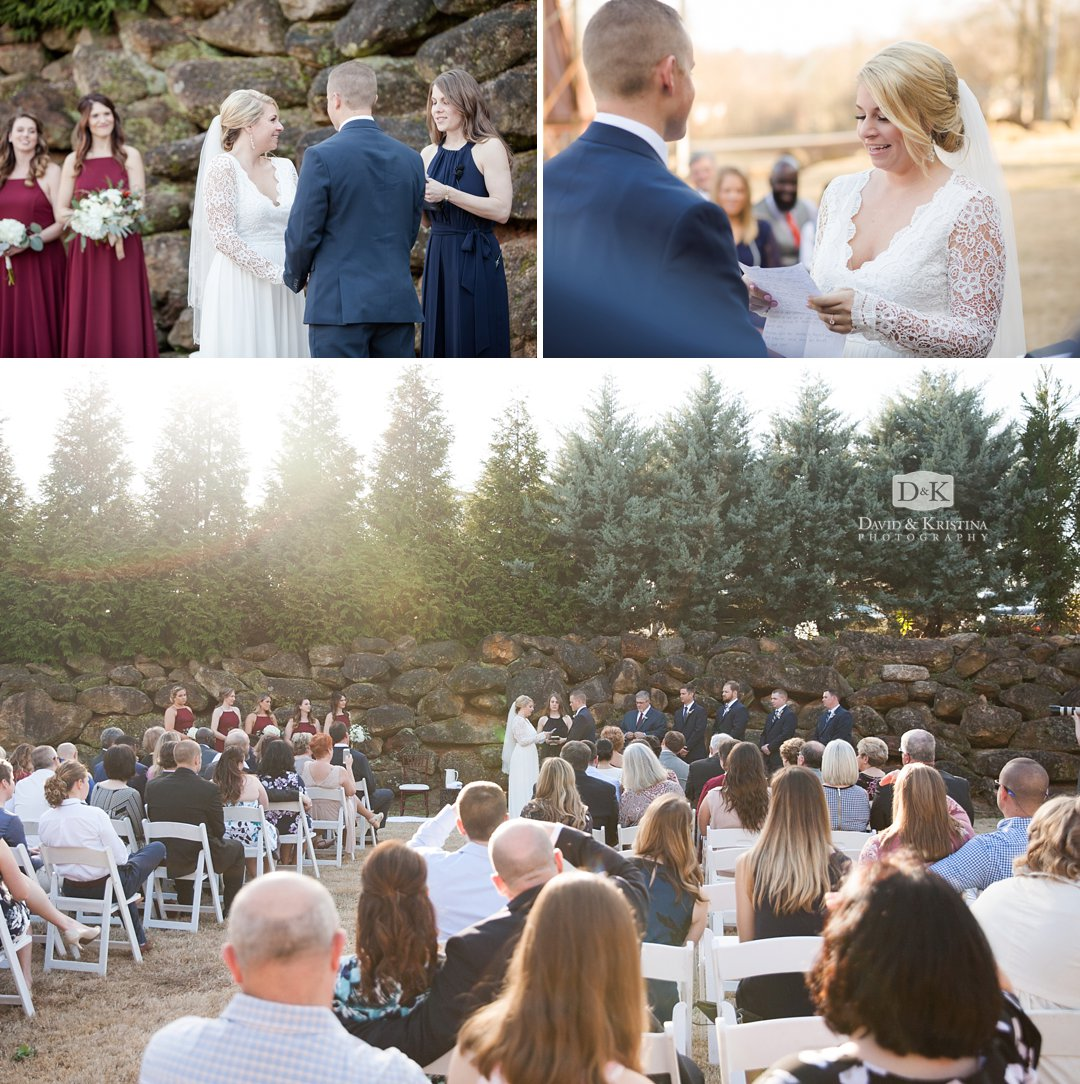 Larkin's Sawmill wedding outdoors in front of rock wall and trees