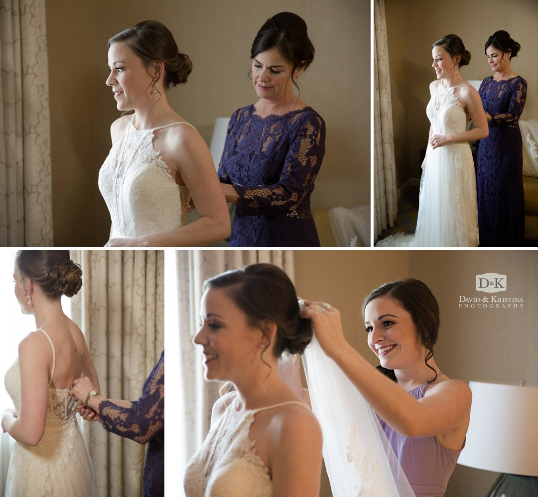 bride putting on dress and veil