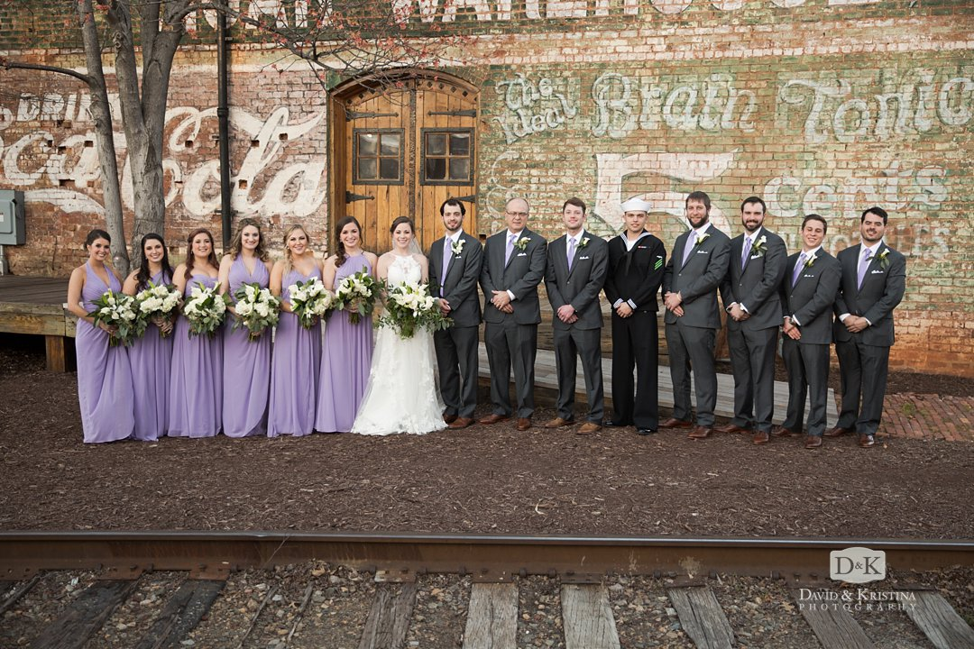 bridesmaids and groomsmen in front of railroad tracks at Old Cigar Warehouse