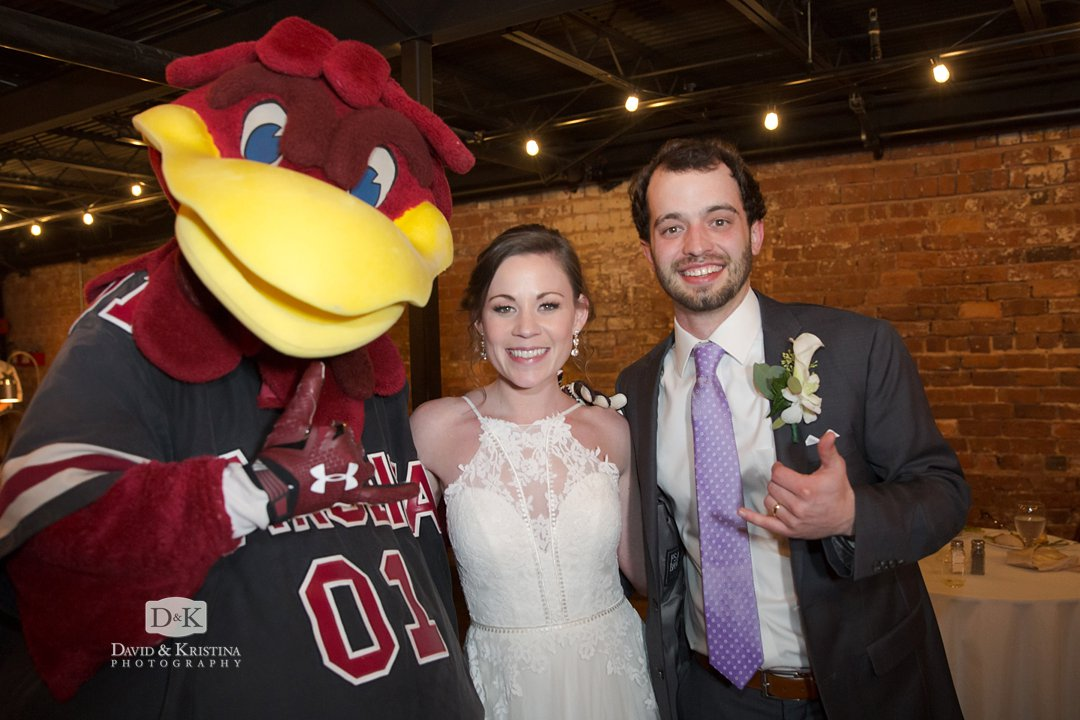 Cocky with the bride and groom
