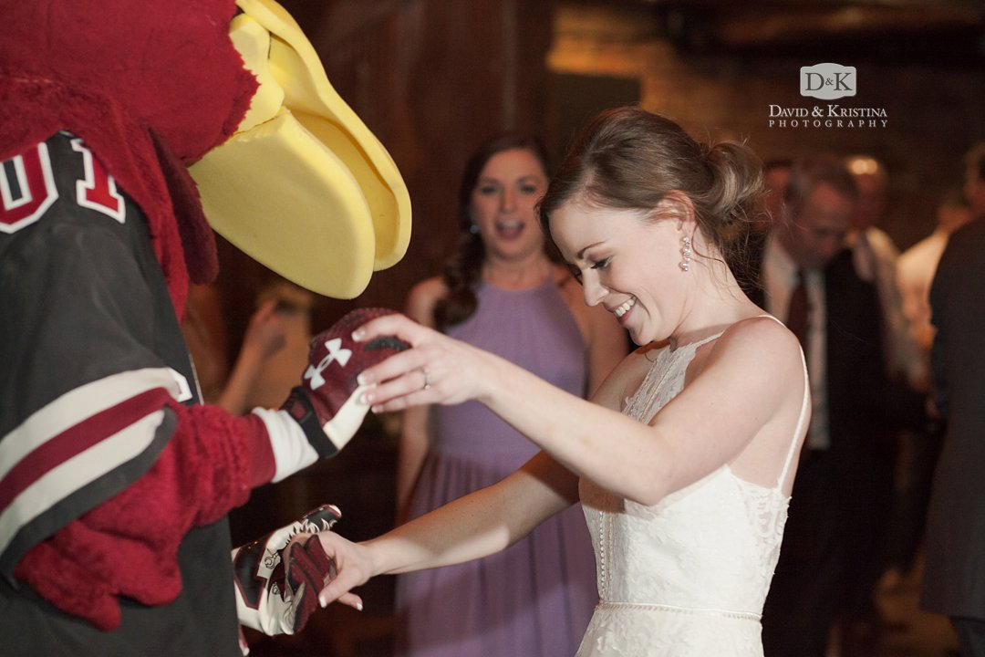 Bride dancing with Cocky Gamecock mascot at wedding